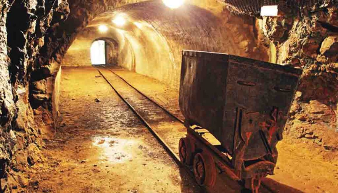 Mine cart on a track in a tunnel